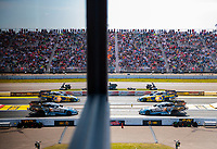 Aug 18, 2019; Brainerd, MN, USA; NHRA funny car driver Shawn Langdon (near) and Ron Capps reflect in a window as they race in the semi finals during the Lucas Oil Nationals at Brainerd International Raceway. Mandatory Credit: Mark J. Rebilas-USA TODAY Sports