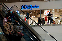 ELIZABETH, NEW JERSEY - MARCH 03: People walk around a local mall on March 03, 2021 in Elizabeth, New Jersey. According projections the EE.UU economy rises 5,5% in 2021. where the excess savings in North American households will return to the market after vaccination and boosting consumption. (Photo by VIEWpress)