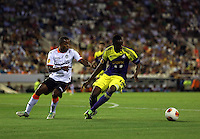 Valencia, Spain. Thursday 19 September 2013<br /> Pictured: Roland Lamah of Swansea (R) marked by Dorlan Pabon of Valencia (L)<br /> Re: UEFA Europa League game against Valencia C.F v Swansea City FC, at the Estadio Mestalla, Spain,