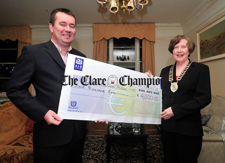 Ian Mc Morrough of Clare Autism Action is presented with a cheque for Ä4,000 by Ann Quinn, incoming President of Soroptimist International Ennis and District at the Old Ground Hotel on Tuesday. Photograph by Declan Monaghan