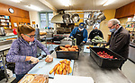 TORRINGTON, CT-122520JS01- Longtime volunteers Susan Levine, Ed Arum, Lisa Hageman, director of the Community Soup Kitchen and Jedd Levine,  prepare Christmas dinner at the Community Soup Kitchen in Torrington on Friday <br /> Jim Shannon Republican-American