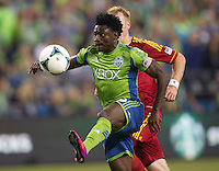 Obafemi Martins of the Seattle Sounders FC gets control of the ball during play against Real Salt Lake at CenturyLink Field in Seattle Friday September 13, 2013. The Sounders won the match 2-0.