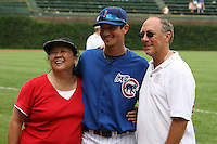 August 9, 2009:  Shortstop Darwin Barney of the Iowa Cubs poses with family after a game at Wrigley Field in Chicago, IL.  Iowa is the Pacific Coast League Triple-A affiliate of the Chicago Cubs.  Photo By Mike Janes/Four Seam Images