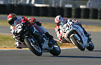 Michael Jordan Racing teammates Ben Bostrum (23) and Roger Hayden (54) race each other during the AMA SuperBike motorcycle race at Daytona International Speedway, Daytona Beach, FL, March 2011.(Photo by Brian Cleary/www.bcpix.com)
