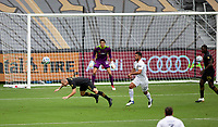 LOS ANGELES, CA - OCTOBER 25: Jordan Harvey #2 of LAFC heads a ball during a game between Los Angeles Galaxy and Los Angeles FC at Banc of California Stadium on October 25, 2020 in Los Angeles, California.