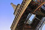 Wide angle view from the bottom of the Eiffel Tower in Paris, France.