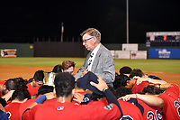 Elizabethton Twins team chaplain Harold Mains conducts a team prayer after winning the Appalachian League Championship Series against the Princeton Rays 2-1 at Joe O'Brien Field on September 5, 2018 in Elizabethton, Tennessee. (Tony Farlow/Four Seam Images)