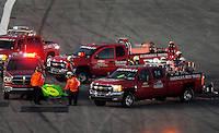 Feb 7, 2009; Daytona Beach, FL, USA; The roof of the car of ARCA RE/MAX Series driver Patrick Sheltra is carried away after being cut off to aid in his extrication after crashing during the Lucas Oil Slick Mist 200 at Daytona International Speedway. Mandatory Credit: Mark J. Rebilas-