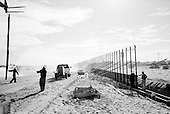 San Luis, Arizona.USA.October 23, 2006..The US National Guard constructs a new fence along the Mexican - USA border near the San Luis port of entry. The fence is placed deep into the ground to keep illegal immigrants from digging under the fence to enter. Thousands of illegal immigrates cross here every year..