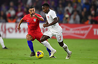 ORLANDO, FL - NOVEMBER 15: Richie Laryea #2 of Canada moves past Sebastian Lletget #17 of the United States during a game between Canada and USMNT at Exploria Stadium on November 15, 2019 in Orlando, Florida.