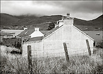 Isle of Lewis and Harris, Scotland:<br /> Fence line and corft houses, near Tarbert