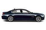 Passenger side profile view of a 2013 BMW 7-Series 750i sedan.
