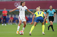 TOKYO, JAPAN - JULY 20: Tobin Heath #7 of the United States moves with the ball during a game between Sweden and USWNT at Tokyo Stadium on July 20, 2021 in Tokyo, Japan.