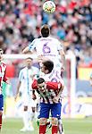 Atletico de Madrid's Koke Resurrecccion (d) and Malaga CF's Ignacio Camacho (t) and Duje Cop during La Liga match. April 23,2016. (ALTERPHOTOS/Acero)