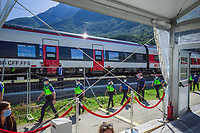 "Switzerland. Canton Ticino. Camorino. Ceneri Base Tunnel (CBT). Official opening ceremony. A group of <br /> police officers from TPO (Transport Police) walk by rails' tracks.TPO (Transport Police) is the Swiss Federal Railways Police. Swiss Federal Railways (German: Schweizerische Bundesbahnen (SBB), French: Chemins de fer fédéraux suisses (CFF), Italian: Ferrovie federali svizzere (FFS)) is the national railway company of Switzerland. It is usually referred to by the initials of its German, French and Italian names, as SBB CFF FFS. The Ceneri Base Tunnel (CBT) (Italian: Galleria di base del Monte Ceneri) is a railway base tunnel in Canton Ticino. It passes under Monte Ceneri between Camorino in the Magadino Flat and Vezia near Lugano, and bypasses the former high-altitude rail route through the Monte Ceneri Tunnel. It is composed of two single-track tunnels, each 15.4 km long. It is another part of the New Railway Link through the Alps (NRLA) project. The impact will be significant on international traffic with shorter time trips. The opening of the Ceneri tunnel also means a transport revolution for the southern canton of Ticino. Regional rail lines will be upgraded, and some reckon the change could lead to the creation of a ""Ticino City"" – one big urban sprawl across the canton. 4.09.2020  © 2020 Didier Ruef"