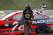 Monster Energy NASCAR Cup Series<br /> Hollywood Casino 400<br /> Kansas Speedway, Kansas City, KS USA<br /> Sunday 22 October 2017<br /> Martin Truex Jr, Furniture Row Racing, Bass Pro Shops / Tracker Boats Toyota Camry celebrates<br /> World Copyright: Barry Cantrell<br /> LAT Images