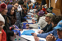 All the musher's who've finished the race as of Saturday March 21st are on hand at the Nome Mini-Convention Center to sign autographs for race fans during Iditarod 2015.  <br /> <br /> (C) Jeff Schultz/SchultzPhoto.com - ALL RIGHTS RESERVED<br />  DUPLICATION  PROHIBITED  WITHOUT  PERMISSION