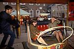 Two girls on a Waltzer. The annual Kings Lynn funfair Mart Norfolk England. Girls being spun spinning around. 1982 1980s UK