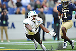 Tulane visits the U.S. Naval Academy and falls to the Navy Midshipmen, 31-14.
