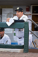 Charlotte Knights manager Julio Vinas (45) watches the action from the dugout during the game against the Durham Bulls at BB&T BallPark on April 14, 2016 in Charlotte, North Carolina.  The Bulls defeated the Knights 2-0.  (Brian Westerholt/Four Seam Images)