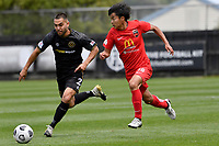 Yuya Taguchi of Canterbury United competes for the ball with Justin Gulley of Team Wellington during the ISPS Handa Men's Premiership - Team Wellington v Canterbury Utd at David Farrington Park, Wellington on Saturday 19 December 2020.<br /> Copyright photo: Masanori Udagawa /  www.photosport.nz