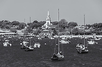 Sailboats and other pleasure craft moored in Nantucket harbor in Nantucket, Massachusetts.