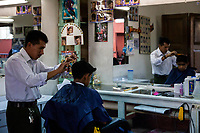 Chichicastenango, Guatemala.  Boy Getting a Haircut.