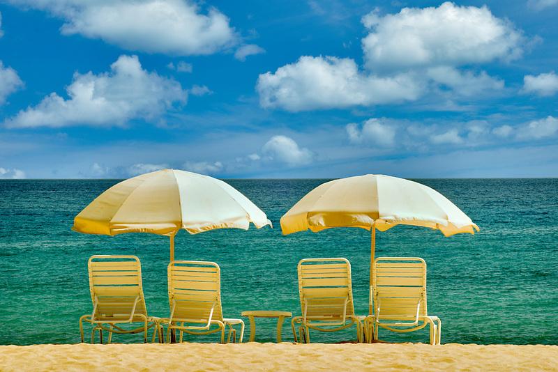 Beach umbrellas and chairs. Beach at Four Seasons, Lanai, Hawaii..