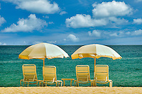 Beach umbrellas and chairs. Beach at Four Seasons, Lanai, Hawaii..