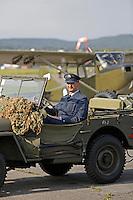 Historical vehicle and Bird Dog (background) at Kjeller. Norwegian Spitfire Foundation invited Norwegian WWII  Spitfire veterans to fly in Spitfire, at the historical airfield Kjeller in Norway.