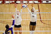 STANFORD, CA - DECEMBER 5:  Alex Fisher and Foluke Akinradewo of the Stanford Cardinal during Stanford's 3-0 win over Albany in the NCAA Division 1 Women's Volleyball first round on December 5, 2008 at Maples Pavilion in Stanford, California.