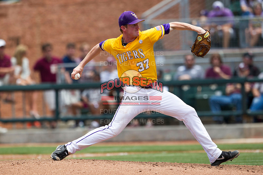 LSU Tigers starting pitcher Ryan Eades (37) delivers a pitch to the plate against the Texas A&M Aggies in the NCAA Southeastern Conference baseball game on May 11, 2013 at Blue Bell Park in College Station, Texas. LSU defeated Texas A&M 2-1 in extra innings to capture the SEC West Championship. (Andrew Woolley/Four Seam Images).