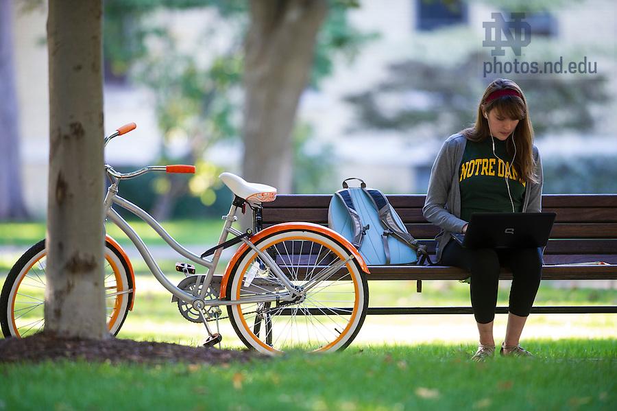 Oct. 8, 2013; Freshman Allyson Scruggs studies on the Main Quad. Photo by Barbara Johnston/University of Notre Dame