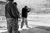Machine Gun Shoot<br /> Knob Creek<br /> Westpoint, Kentucky<br /> USA<br /> April 4, 2009<br /> <br /> Nearly 16,000 people attend the Knob Creek Machine Gun Shoot & Military Gun Show. It is the largest gathering of Civilian owned machine guns in the world. The gun show has over 700 tables with machine guns, military surplus, ammo, hard to find parts & pieces and regular firearms and supplies.<br /> <br /> In defined areas certain automatic weapons can be fired by anyone, including children, for a fee.<br /> <br /> Firearms sales have surged in the six months since Obama's election as millions of Americans have gone on a buying spree that has stripped gun shops in some parts of the country almost bare of assault weapons and led to a national ammunition shortage.<br /> <br /> The FBI says that since November more than seven million people applied for criminal background checks in order to buy weapons, a figure excluding the many more buying at thousands of gun shows in states such as Virginia, without facing any checks.<br /> <br /> Gun-shop owners and the National Rifle Association say the surge is driven by worries that Obama is planning to ban many types of firearms and that the deepening economic crisis will fuel a crime wave, as witnessed by the string of mass shootings in the past few weeks.<br /> <br /> But control groups pressing for greater control on firearms accuse the NRA of funding a massive scare campaign to portray Obama as a gun owner's worst nightmare and to argue that tighter restrictions on weapons ownership are a threat to broader liberties and a step toward tyranny.