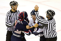 A fight breaks out during hockey action at Charlotte Checker minor league hockey game at Time Warner Cable Arena in Charlotte, NC.