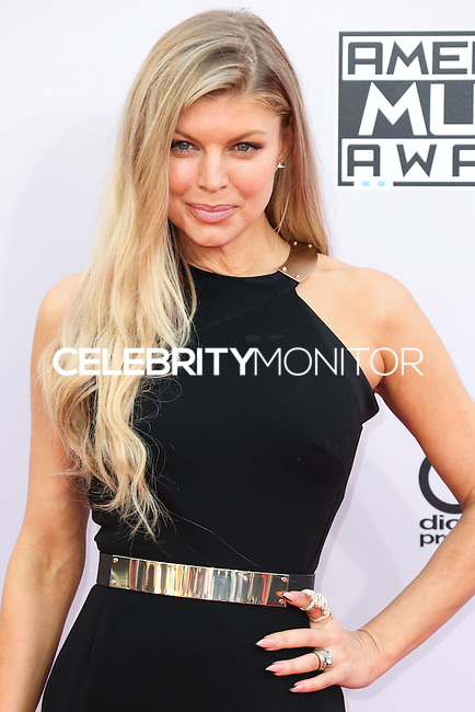 LOS ANGELES, CA, USA - NOVEMBER 23: Fergie arrives at the 2014 American Music Awards held at Nokia Theatre L.A. Live on November 23, 2014 in Los Angeles, California, United States. (Photo by Xavier Collin/Celebrity Monitor)