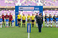 ORLANDO, FL - MARCH 05: The military escort stands on the field with the SheBelieves Trophy during a game between Spain and Japan at Exploria Stadium on March 05, 2020 in Orlando, Florida.