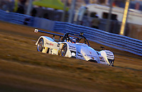 .Team Seattle's #15 SRP II Nissan/Lola sppeds through the infield at sunset...