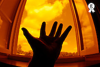 Man with outstretched hand by window, close up of hand, fish eye view (Licence this image exclusively with Getty: http://www.gettyimages.com/detail/74583303 )