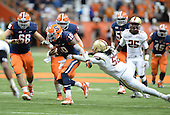 Syracuse Orange quarterback Terrel Hunt (10) breaks the tackle of linebacker Steven Daniels (52) during a game against the Boston College Eagles at the Carrier Dome on November 30, 2013 in Syracuse, New York.  Syracuse defeated Boston College 34-31.  (Copyright Mike Janes Photography)