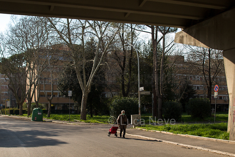 Food shopping: allowed.<br /> <br /> Rome, 18/03/2020. Rome's Olympic Village district under the Italian Government lockdown for the Outbreak of the Coronavirus SARS-CoV-2 - COVID-19. On 22 March, the Italian PM Giuseppe Conte signed a new Decree Law which suspends non-essential industry productions and contains the list of allowed working activities, which includes Pharmaceutical & food Industry, oil & gas extraction, clothes & fabric, tobacco, transports, postal & banking services (timetables & number of agencies reduced), delivery, security, hotels, communication & info services, architecture & engineer, IT manufacturers & shops, call centers, domestic personnel (1.).<br /> Updates: Italy: 22.03.20, 6:00PM: 46.638 positive cases; 7.024 recovered; 5.476 died.<br /> <br /> The Rome's Olympic Village (1957-1960) was designed by: V. Cafiero, A. Libera, A. Luccichenti, V. Monaco, L. Moretti. «Built to host the approximately 8,000 athletes involved in the 1960 Olympic Games, Rome's Olympic Village is a residential complex located between Via Flaminia, the slopes of Villa Glori and Monti Parioli. It was converted into public housing [6500 inhabitants, ndr] at the end of the sporting event. The intervention is an example of organic settlement, characterized by a strong formal homogeneity, consistent with the Modern Movement's principles of urbanism. The different architectural structures are made uniform by the use of some common elements: the pilotis, ribbon windows, concrete stringcourses, and yellow brick curtain covering. At the center of the neighborhood, the Corso Francia viaduct - a road bridge about one kilometer long - was built by P.L. Nervi[…]» (2.).<br /> <br /> Info COVID-19 in Italy: http://bit.do/fzRVu (ITA) - http://bit.do/fzRV5 (ENG)<br /> 1. March 22nd Decree Law http://bit.do/fFwJn (ITA)<br /> 2. (Atlantearchitetture.beniculturali.it MiBACT, ITA - ENG) http://bit.do/fFw3H<br /> 12.03.20 Rome's Lockdown for the Outbreak of the Coronavirus SARS-CoV-2 - C