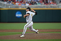 Carson Fulmer #15 of the Vanderbilt Commodores pitches during Game 2 of the 2014 Men's College World Series between the Vanderbilt Commodores and Louisville Cardinals at TD Ameritrade Park on June 14, 2014 in Omaha, Nebraska. (Brace Hemmelgarn/Four Seam Images)
