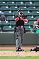 Home plate umpire Erich Bacchus makes a strike call during the Carolina League game between the Myrtle Beach Pelicans and the Winston-Salem Dash at BB&T Ballpark on May 10, 2015 in Winston-Salem, North Carolina.  The Pelicans defeated the Dash 4-3.  (Brian Westerholt/Four Seam Images)