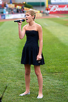 Erie Seawolves national anthem singer Ashlyn Keenan performs before an Eastern League game against the New Hampshire Fisher Cats at Jerry Uht Park on August 9, 2012 in Erie, Pennsylvania.  Erie defeated New Hampshire 6-0.  (Mike Janes/Four Seam Images)