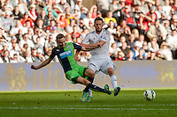 Saturday 4th  October 2014 Pictured: Gylfi Sigurosson of Swansea City ( right ) <br /> Re: Barclays Premier League Swansea City v Newcastle United at the Liberty Stadium, Swansea, Wales,UK