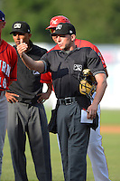Umpire George Reidel goes over the ground rules before a game between the Williamsport Crosscutters and Auburn Doubledays on July 8, 2013 at Bowman Field in Williamsport, Pennsylvania.  Auburn defeated Williamsport 5-1.  (Mike Janes/Four Seam Images)
