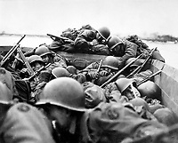 """""""I drew an assault boat to cross in - just my luck.  We all tried to crawl under each other because the lead was flying around like hail.""""  Crossing the Rhine under enemy fire at St. Goar, March 1945.  Army. (OWI)<br /> Exact Date Shot Unknown<br /> NARA FILE #:  208-YE-132<br /> WAR & CONFLICT BOOK #:  1086"""