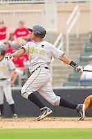 Elias Diaz #30 of the West Virginia Power follows through on his swing against the Kannapolis Intimidators at Fieldcrest Cannon Stadium on April 20, 2011 in Kannapolis, North Carolina.   Photo by Brian Westerholt / Four Seam Images