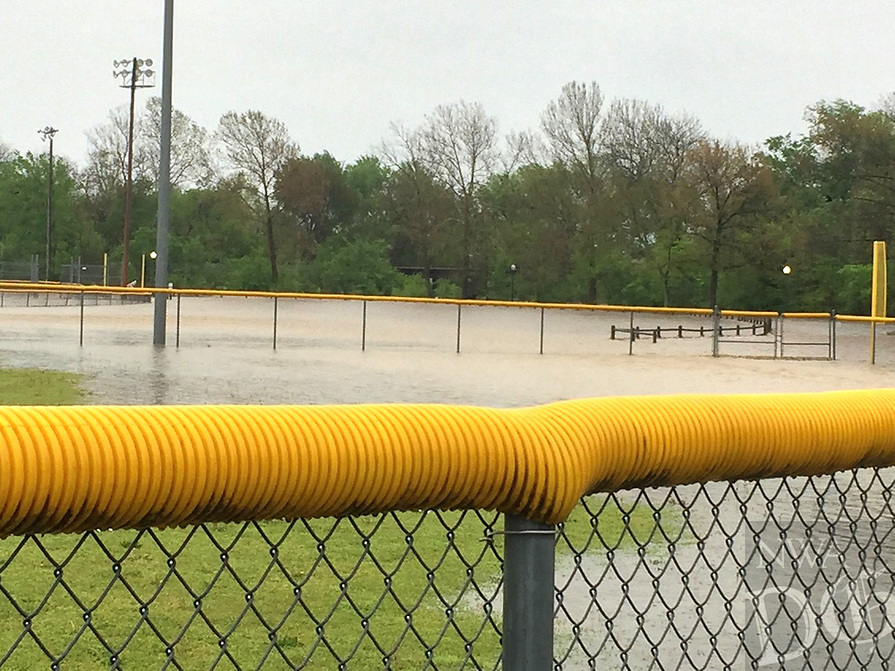 Graham Thomas/Herald-Leader<br /> Flash flooding at La-Z-Boy Sports Complex off Lincoln Street in Siloam Springs on Wednesday morning