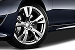 Tire and wheel close up detail view of a 2011 Infiniti M37S Sedan